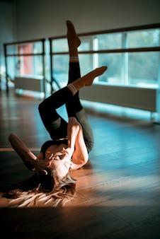 Professional female dancer posing on the floor