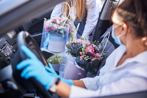 Professional female florist on a flower delivery duty