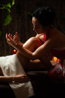 Professional female masseurs do massage in the health center