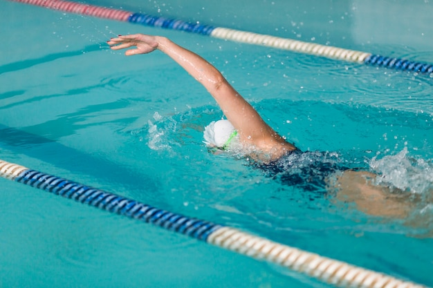 Professional female swimmer swimming
