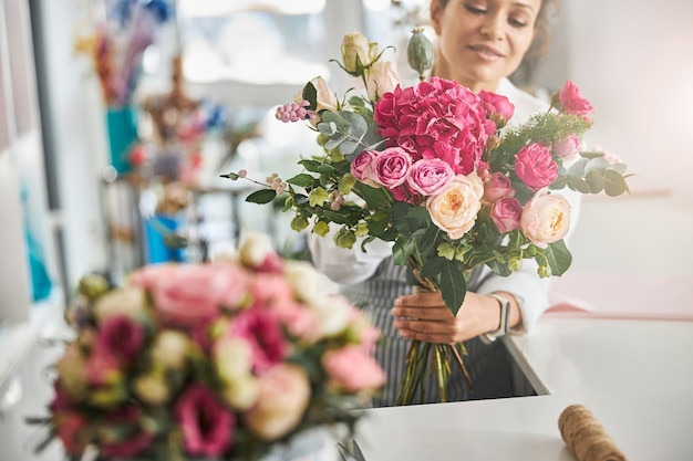 Professional florist posing with a gorgeous floral composition