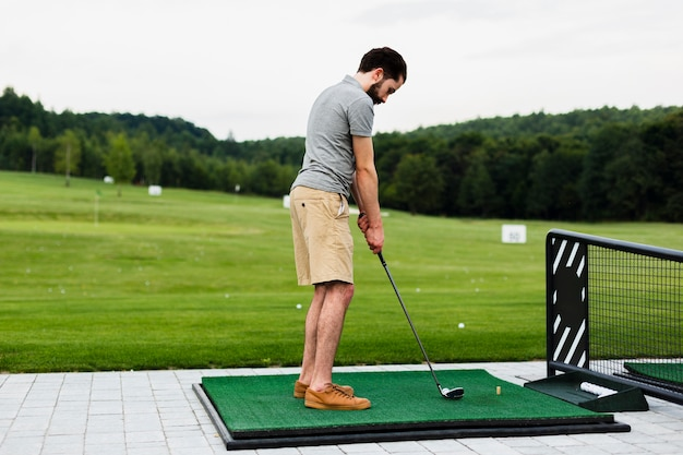 Professional golf player practising on a golf field