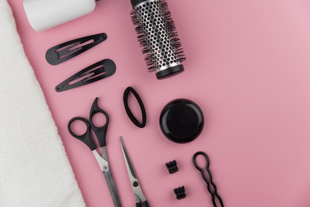 Professional hair dresser toolse. hair stylist equipment set on pink background.
