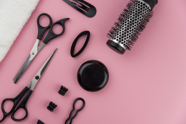 Professional hair dresser toolse. hair stylist equipment set on pink background.