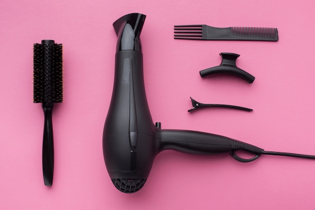 Professional hair dryer in flat lay