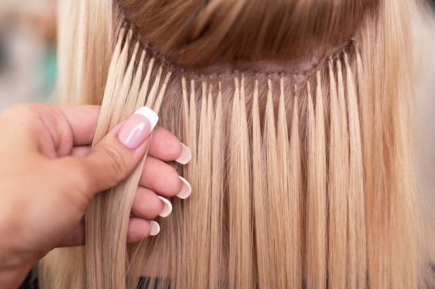 Professional hair extension in hairdressing salon