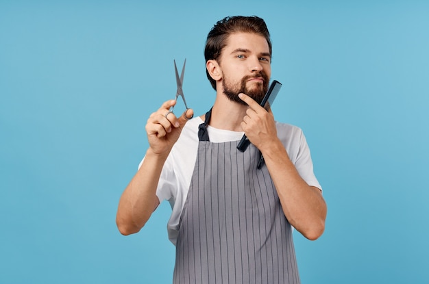 Professional hairdresser in gray aprons fashionable hairstyle bushy beard s