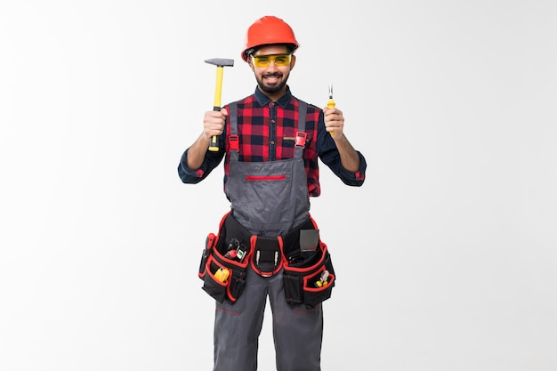 Professional indian handyman with construction tools. house renovation.