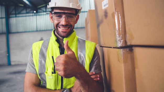 Professional industry worker close up portrait in the factory or warehouse