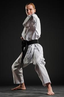 Professional karate woman practicing full shot