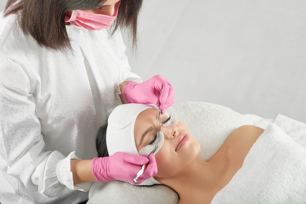 Professional lashmaker making long beatiful lashes