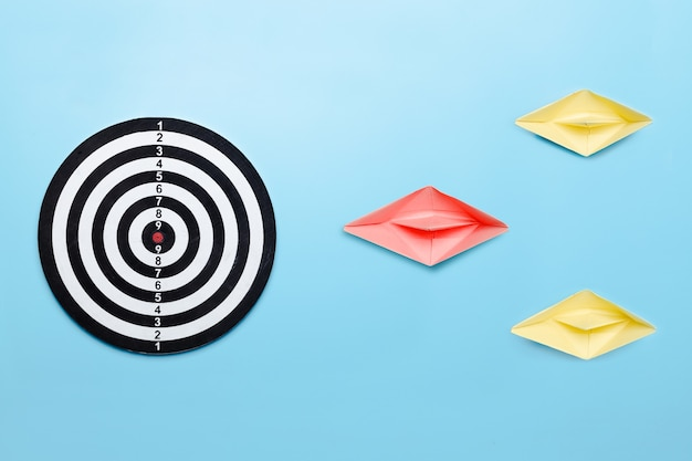 Professional leader lead to target of business concept, boat paper boss guide ahead to dartboard