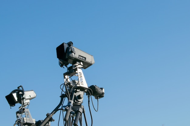 Professional lighting equipment for concerts against the blue sky