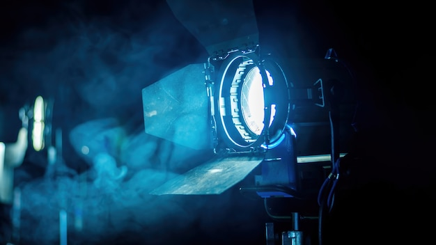 Professional lighting equipment on the movie set with smoke in the air