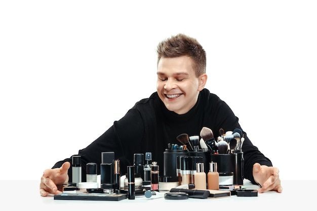 Professional makeup artist with tools isolated on white . the man in female profession. gender equality concept
