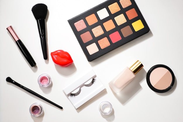 Professional makeup products with cosmetic beauty products, eye shadows, pigments, lipsticks, brushes and tools.