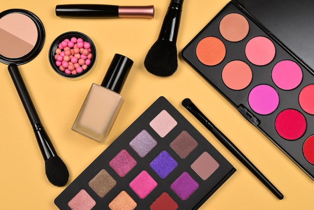 Professional makeup products with cosmetic beauty products, foundation, lipstick,  eye shadows, eye lashes, brushes and tools.