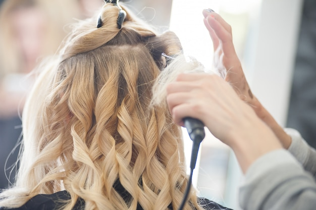 Professional makeup for a woman in a beauty studio