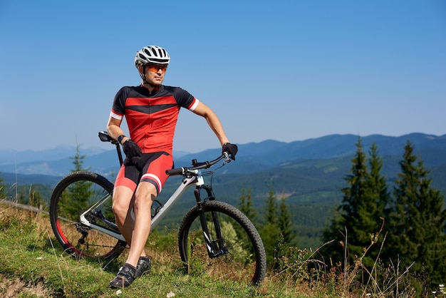 Professional male biker cycling bicycle on trail