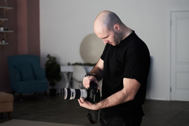 Professional male photographer taking pictures in a studio