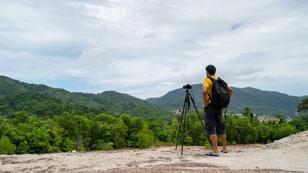Professional man photography on high mountain take a picture landscape nature view at phuket thailand.