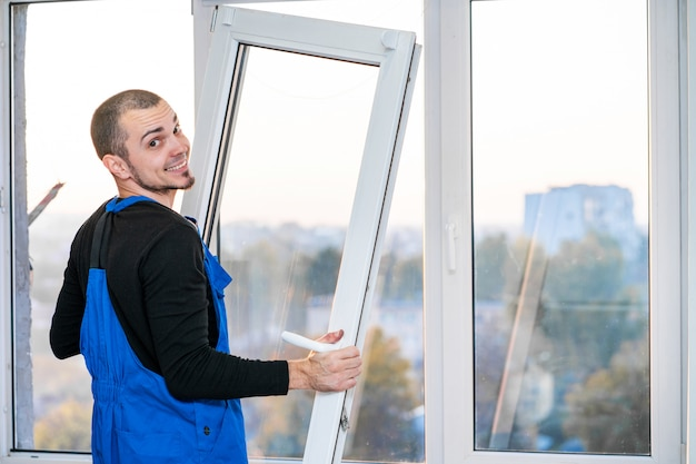 Professional master at repair and installation of windows, at work