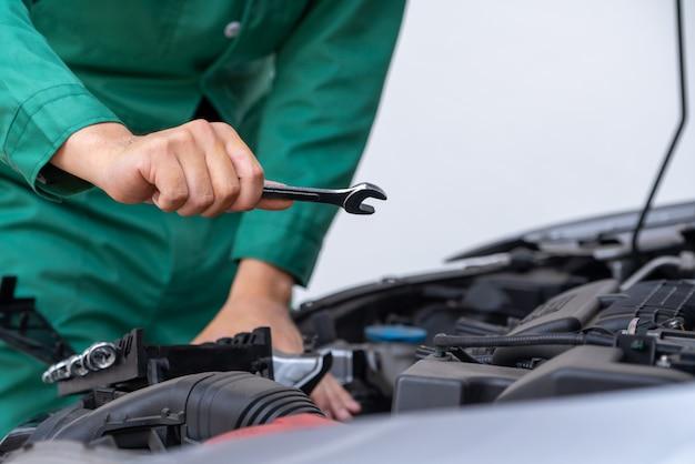 Professional mechanic hand providing car repair and maintenance service
