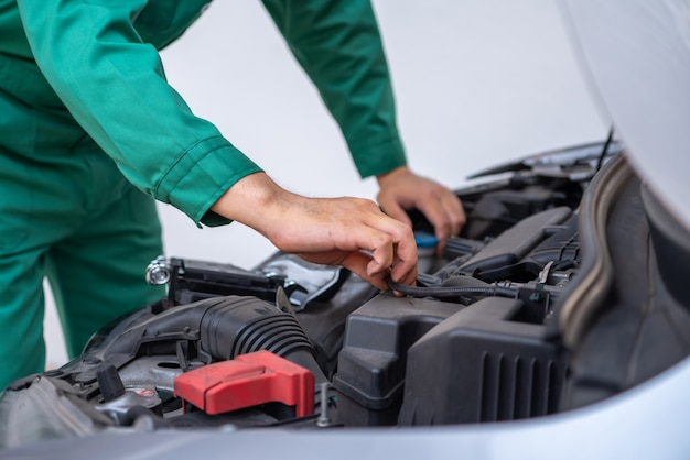 Professional mechanic hand providing car repair and maintenance service