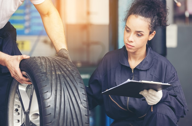Professional mechanical employee of a car tire service, good a technical service in the garage