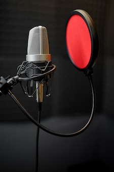 Professional microphone closeup, recording studio equipment, nobody. audio, sound and music record in best quality