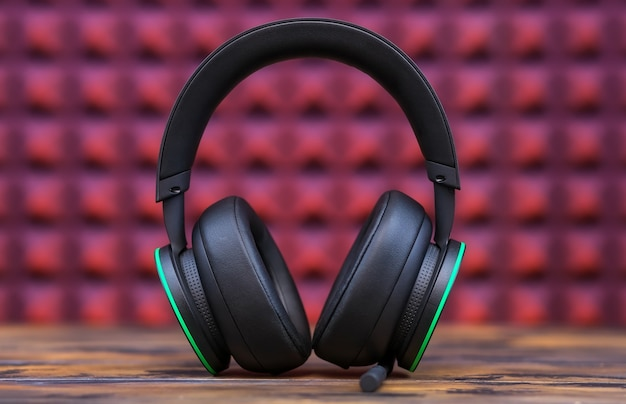 Professional modern headphones with a microphone for gamers on a pink background