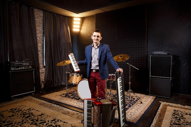 Professional musician with studio keyboard synthesizer