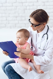 Professional pediatrician doctor exam newborn.
