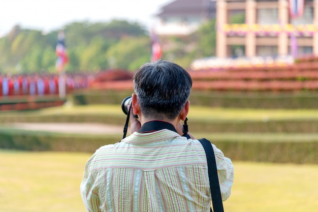 Professional photographer concentrate and continue his passion for photography