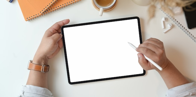 Professional photographer drawing on blank screen tablet