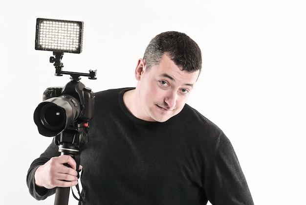 Professional photographer standing near the tripod