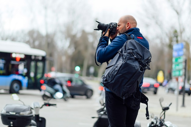 Professional photographer taking a photo in the street