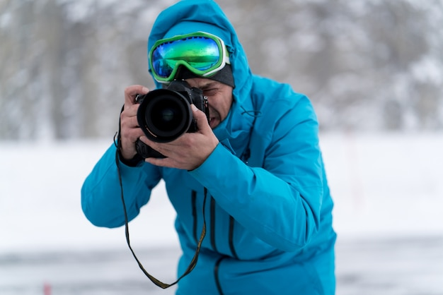 Professional photographer on task in winter wilderness