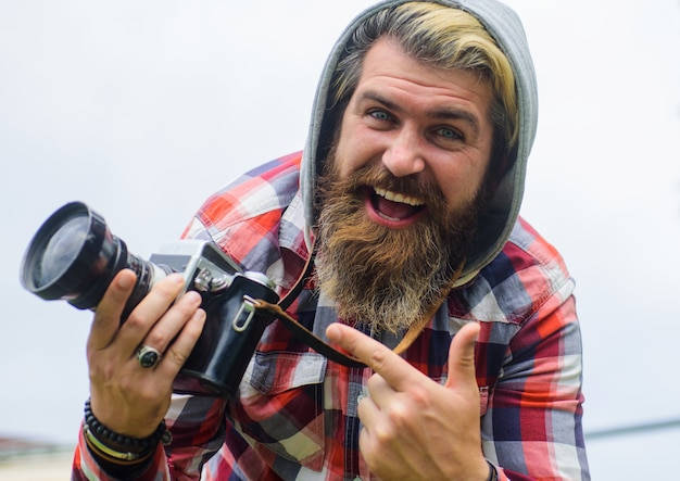 Professional photographer traveler taking photographs on digital cameraon street.