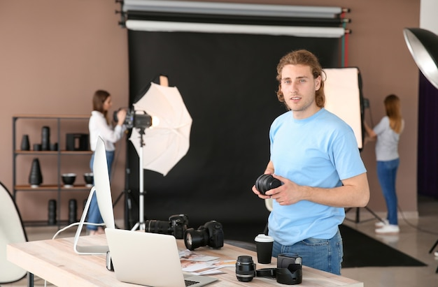 Professional photographer working in modern studio