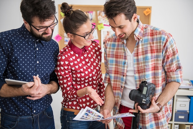 Professional photographers working at their office
