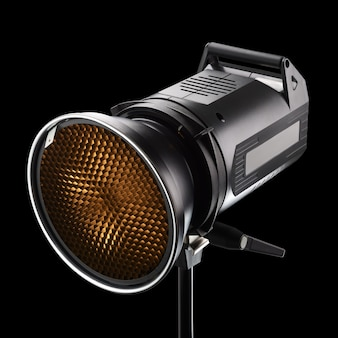 黒の背景にハニカムとプロの写真スタジオフラッシュ、ストロボまたはライト