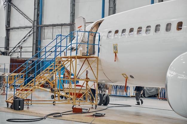 Professional plane expluatation service in big hangar