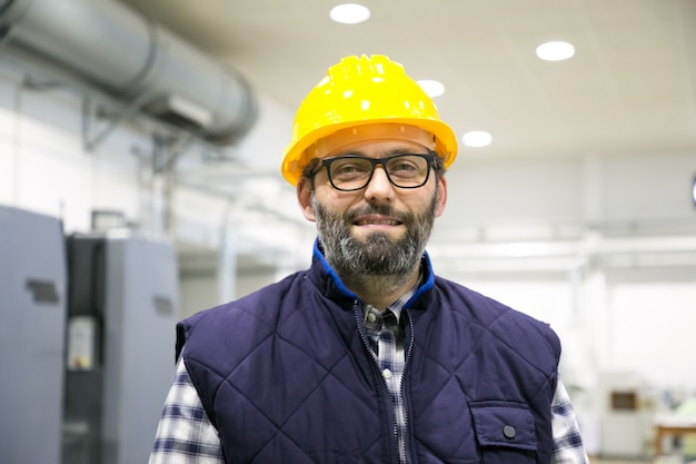 Professional portrait of positive smiling industrial worker