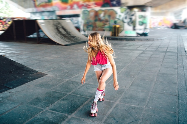 Professional rollerblader is riding in special training room