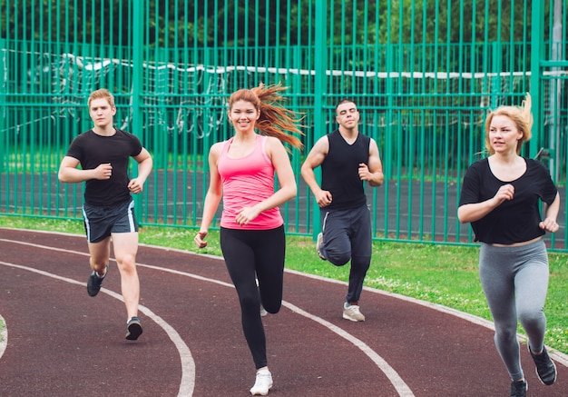Professional runners running on a race track.