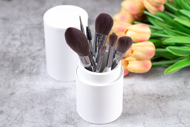 Professional set of make-up brushes and tools in cosmetic box