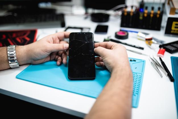 Professional smart phone repair shop or service. close up shot. electronics concept.