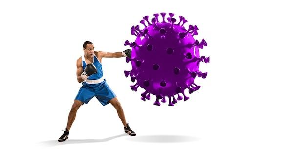 プロのスポーツマンがコロナウイルスモデルを蹴ったり、パンチしたりします-病気と戦い、強く、安全になりましょう。目標達成、スポーツ、健康的なライフスタイル、肺炎の治療covid-19。競争、チャンピオンシップ。