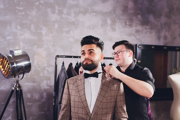 Professional tailor taking measurements for sewing suit